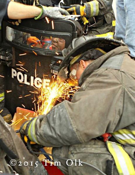 fireman uses a saw
