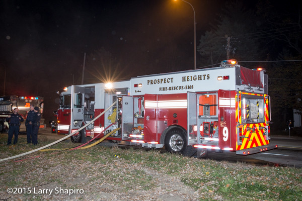 Spartan fire engine with lines off at night