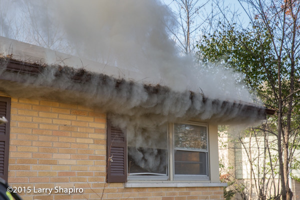 smoke vents from window at house fire