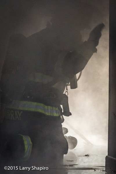firefighter inside smokey building