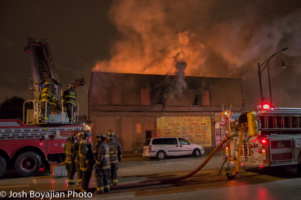 commercial building on fire at night