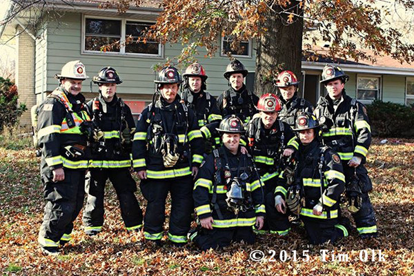 firemen pose for group photo