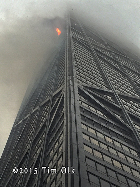 fire blows out of the John Hancock Building Chicago