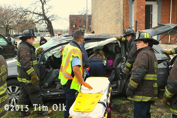 firefighters remove patient after car crash