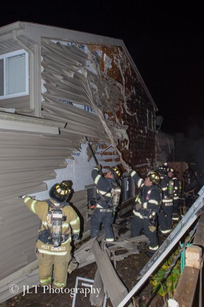 firemen overhaul house after fire