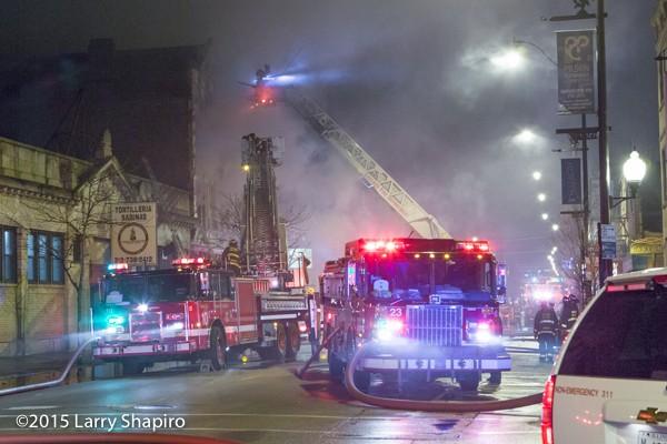Chicago fire trucks at night fire scene