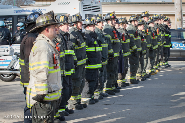 firefighters at attention