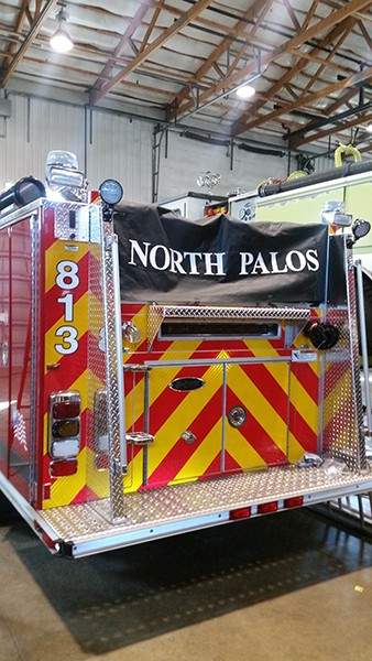 chevron on back of fire truck with custom hose cover