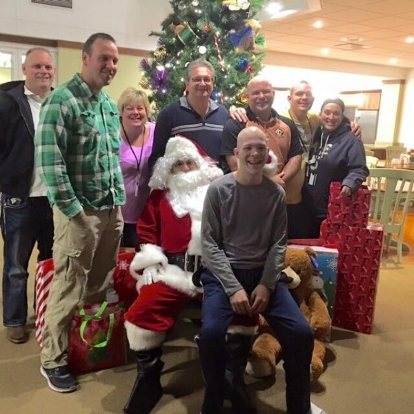 North Riverside firefighters deliver Christmas gifts to patients at the Ronald McDonald house