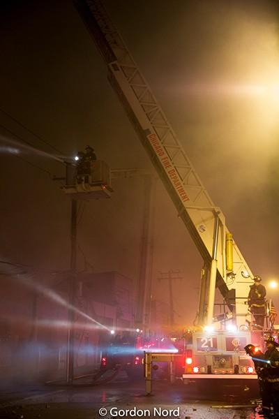massive building fire scene in Chicago at night
