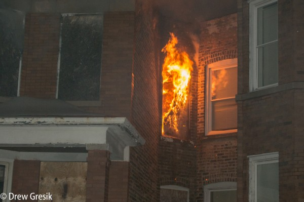 fire blows out window of vacant building
