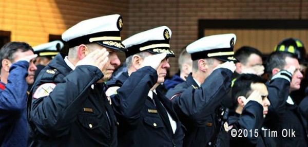 firefighters honor a fallen brother