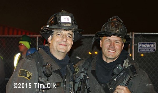 Chicago firefighters posing at fire scene
