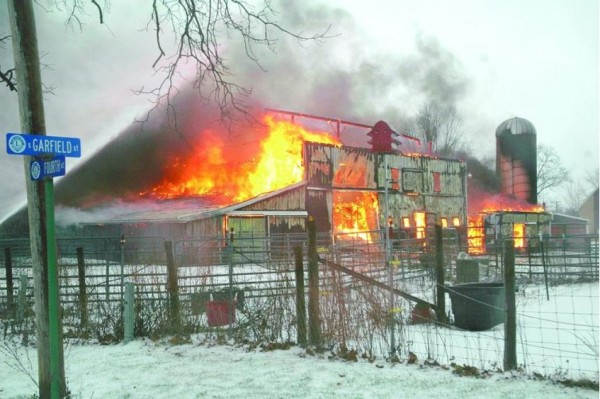barn fully engulfed in flames