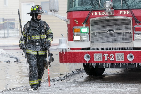 firefighter and fire truck covered with ice