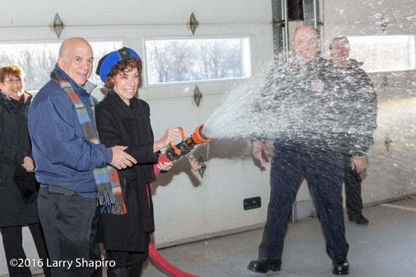 parents hose down new fire engine