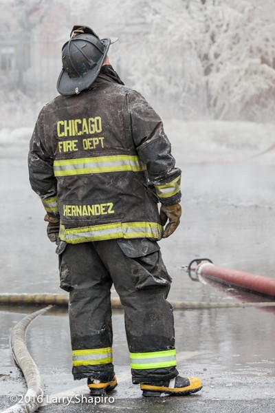 Chicago firefighter at winter fire scene with ice