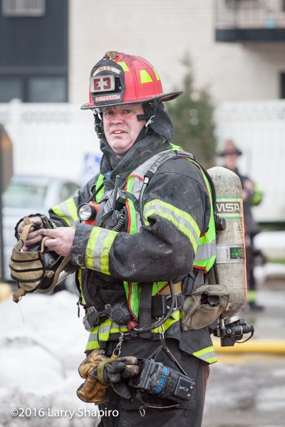 firefighter with dirty face after battling a fire