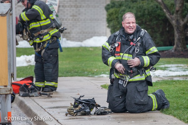 fireman rests after fighting a fire