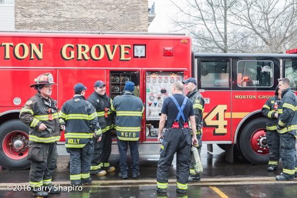 firemen refill air bottles at scene