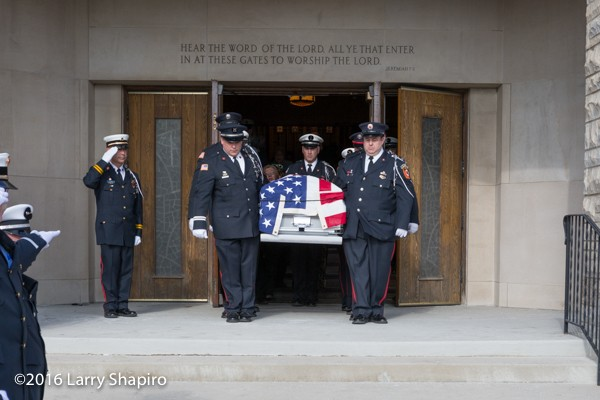 fire department honor guard carries casket