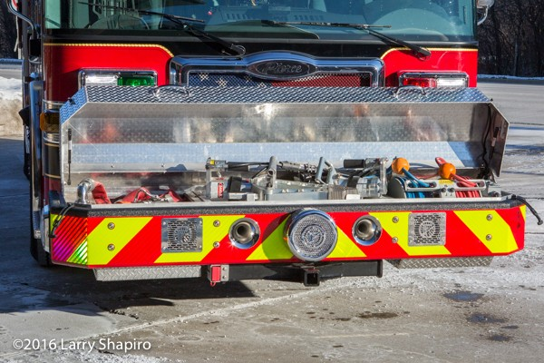 fire truck with hydraulic tools in the front bumper