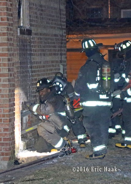 Chicago firefighters at house fire