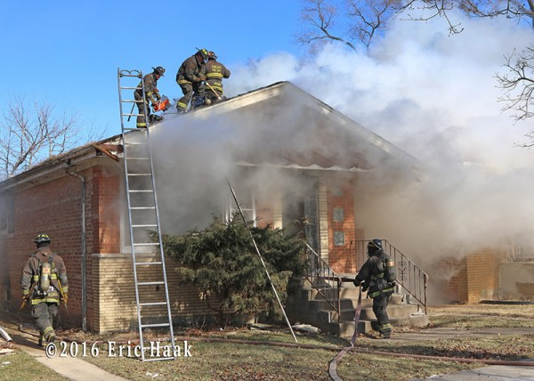 Chicago firefighters battle house fire