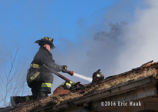 Chicago firefighter with hoe at house fire