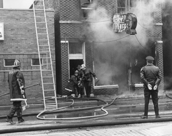 historic fire scene image of a victim rescue