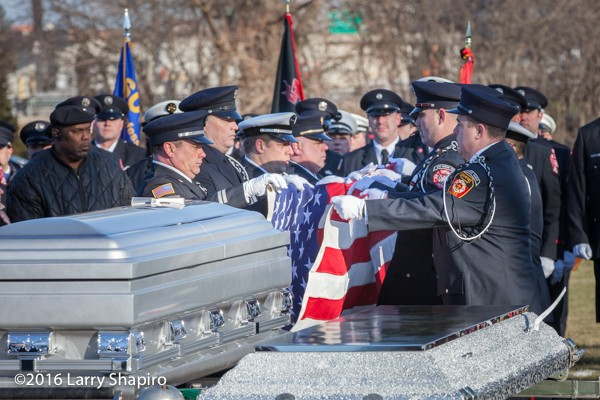 fire department honor guard folds flag