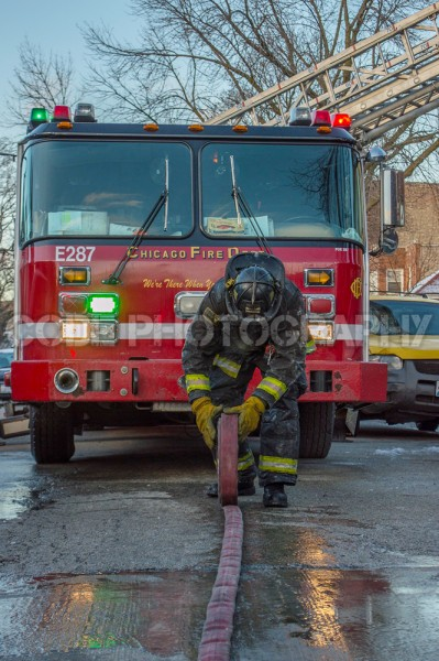 fireman rolling hose after fire