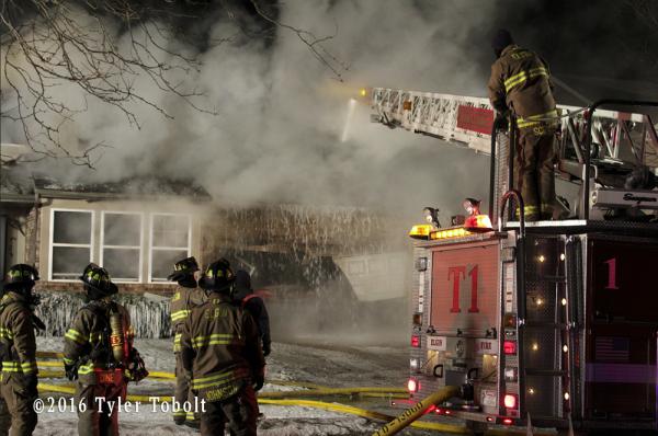 Seagrave fire truck at night fire scene