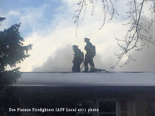firefighters on roof of house to vent during fire