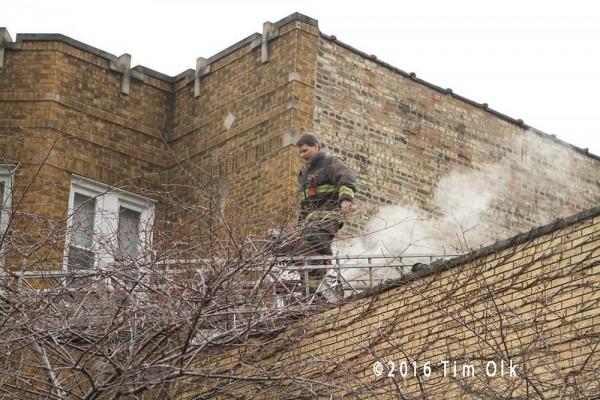 fireman on aerial ladder