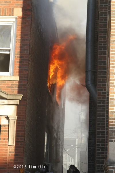 fire blowing out of apartment window