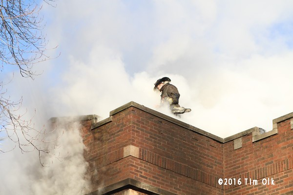 fireman on roof with smoke
