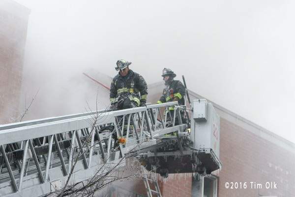 firemen descend aerial ladder