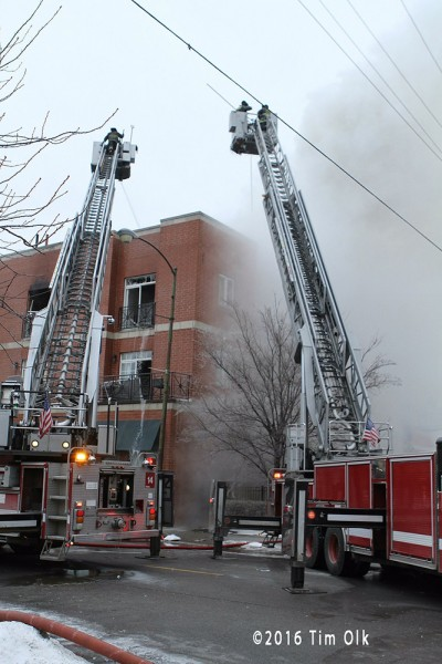 two tower ladders at fire scene