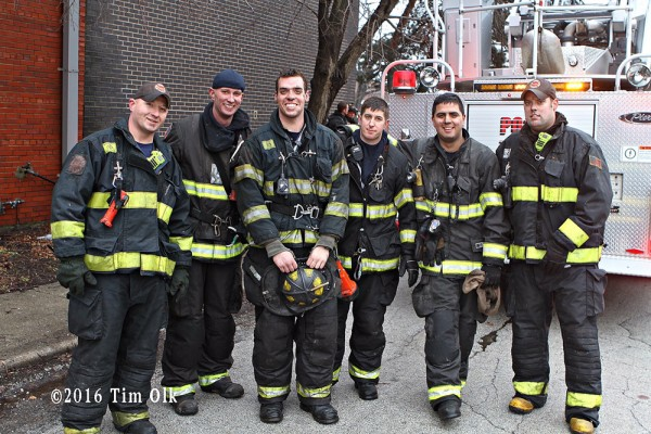 firefighters pose after fire