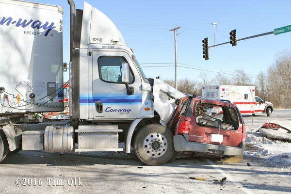 tractor-trailer crushes small SUV