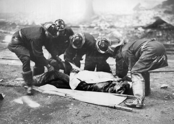 historic photo of firemen attending to a fallen comrade