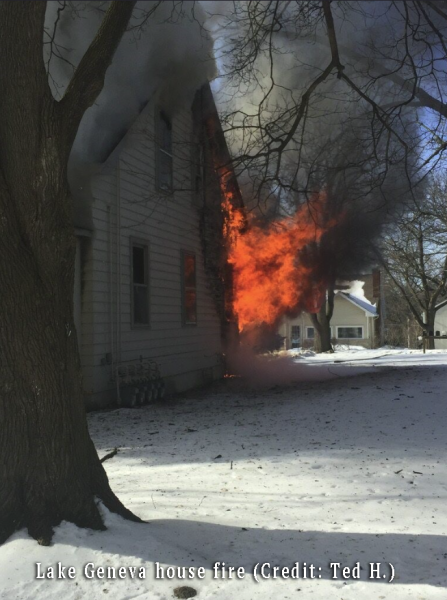 fire billows from burning house