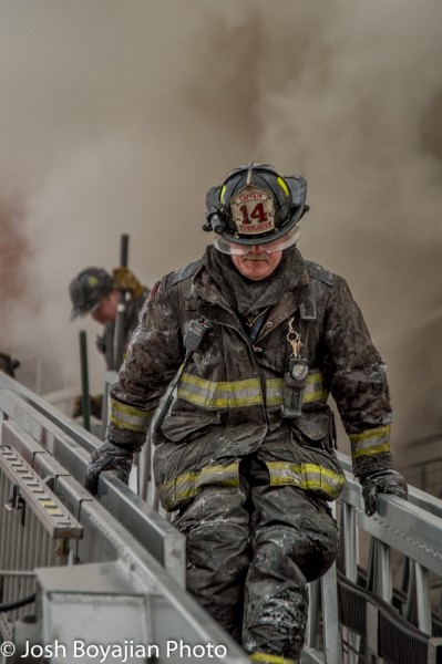 firefighter coated with ice at winter fire