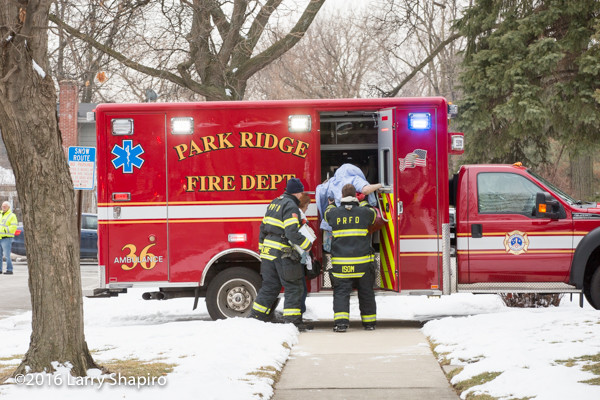 firefighter paramedics assist residents after house fire