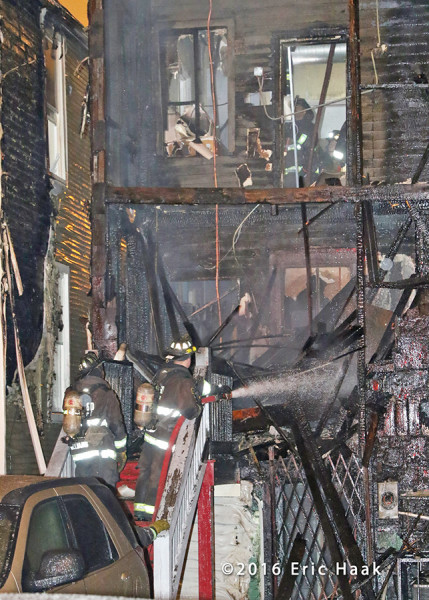 firemen overhaul after back porches burned in Chicago