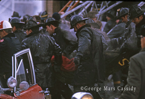 historic Chicago fire scene photo as firemen recovery a fallen firemen