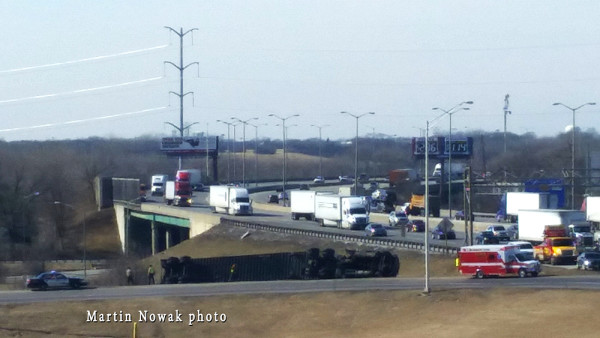 over turned tractor trailer on a highway ramp
