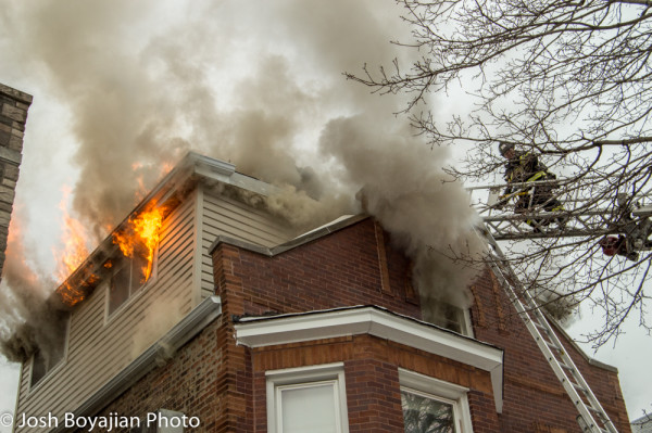 flames and smoke from house fire in Cicero IL