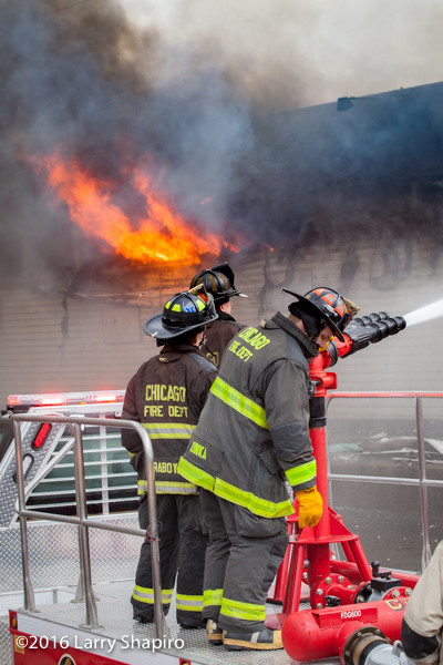 Chicago firefighters battle a commercial fire